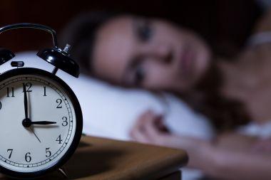 depositphotos_60092493-stock-photo-alarm-clock-on-night-table.jpg