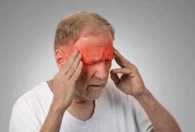 depositphotos_70159777-stock-photo-senior-man-suffering-from-headache.jpg