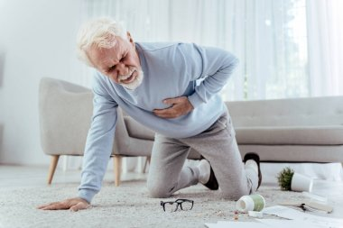 depositphotos_202372806-stock-photo-sick-senior-man-falling-from.jpg